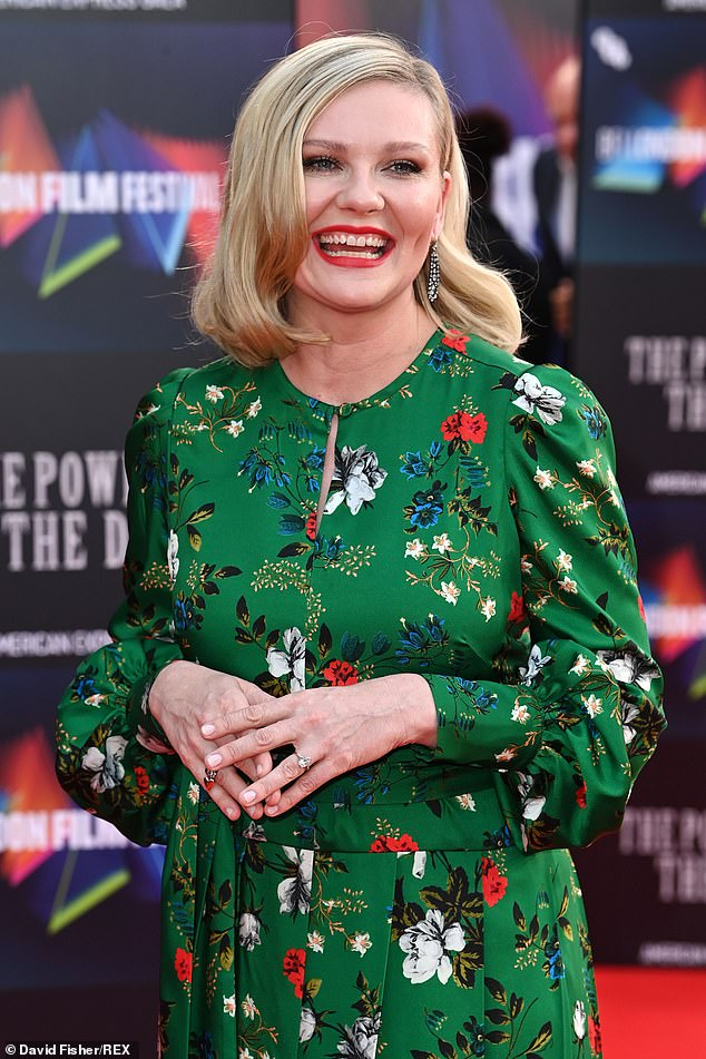 Beauty: The actress wore a green floral gown with keyhole opening at the front and puffy sleeves