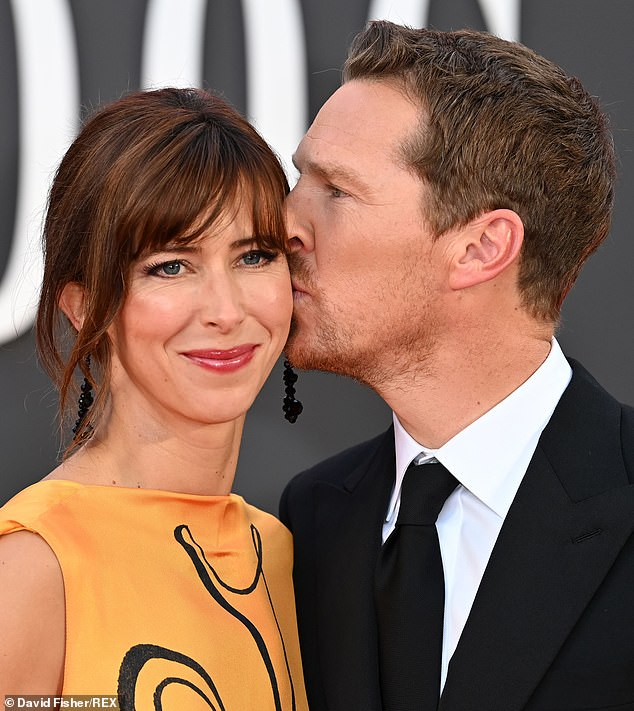 SWEET: Benedict draws attention to his wife Sophie's cheek by kissing her before entering the Royal Festival Hall