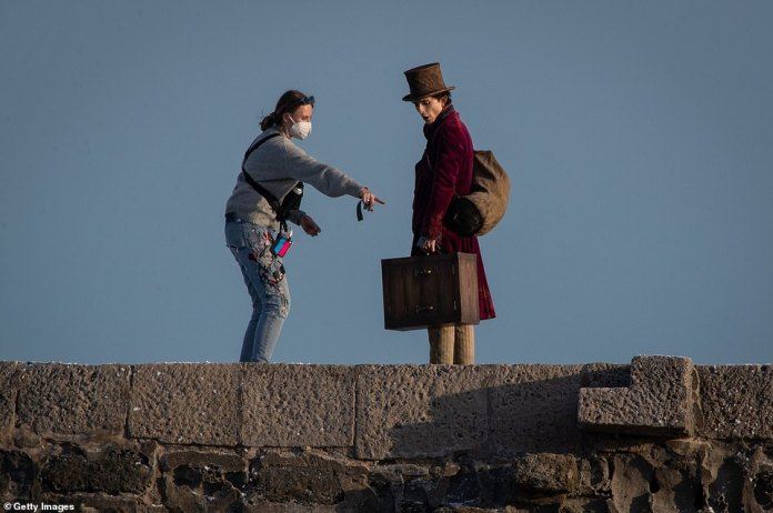 Over there: Timothee was directed as he prepared to film a scene