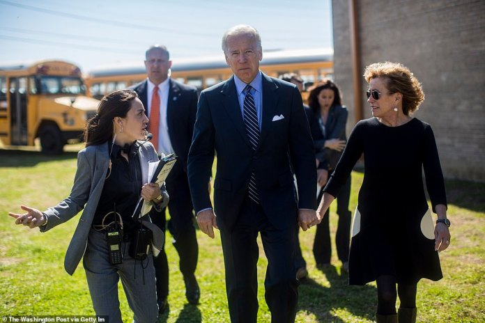 Owens is the son of Biden's sister Valerie Owens, pictured right next to President Biden in black and white dress in 2013