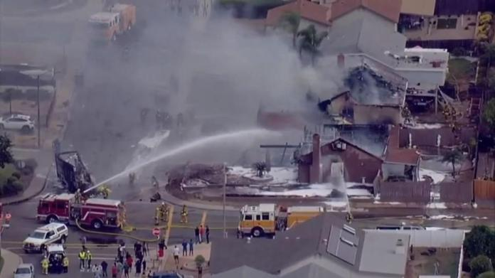 Firefighters in the San Diego suburb of Santee, California are at the scene of a small plane crash near a high school on Monday