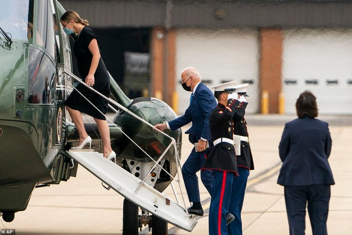 President Biden (right) and granddaughter Naomi Biden board Marine One at Delaware Air National Guard Base at the end of his long holiday weekend on Monday
