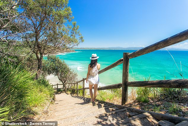 Prime Minister Scott Morrison has pledged to fast-track international travel for NSW residents once home quarantine becomes available (pictured, a woman in Byron Bay)