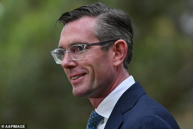 Pictured is NSW Premier Dominic Perrottet on Tuesday. His state is on track to hit the 80 per cent Covid vaccination milestone this weekend - triggering the reopening of nightclubs and allowing fans back into stadiums
