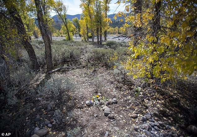 A stone cross marks a spot in northwest Wyoming's Bridger-Teton National Forest, Thursday, September 23, 2021, where the remains of Gabrielle 'Gabby' Petito were discovered on September 19.A private investigator has suggested that Gabby Petito may have died from asphyxiation after he recently visited the site where her remains here discovered