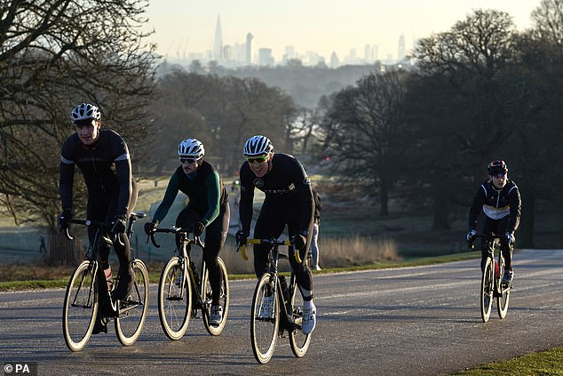 A group of cyclists make their way through Richmond Park in London (file picture)