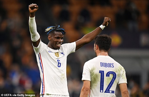 Pogba celebrates with teammate Leo Dubois at the final whistle after a super performance
