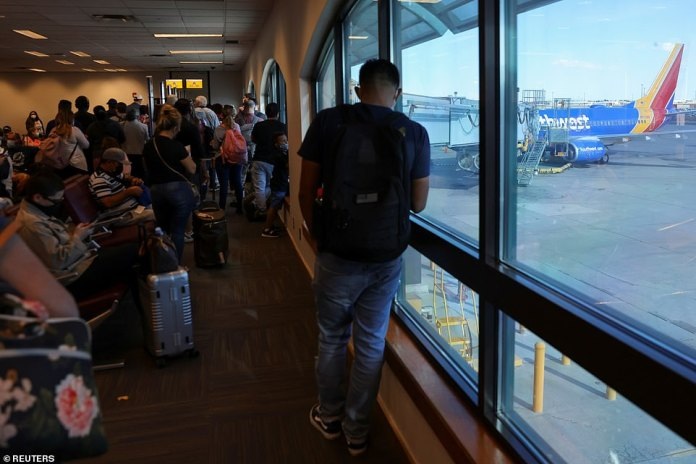 Passengers at the Southwest terminal in El Paso, Texas wait to board a flight on Monday