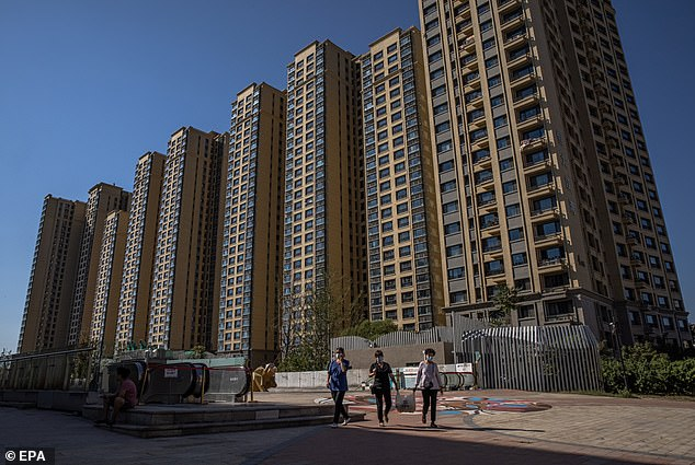China's over-leveraged property sector could spell disaster for Australia's resources-rich economy with a slow down in Sino construction meaning commodity prices are likely to tank. Pictured:Evergrande city plaza in Beijing