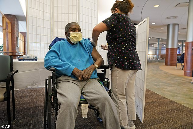 NY Health Commissioner Dr Howard Zucker said the new study shows that 'getting a COVID-19 vaccine is the best way out of this pandemic'.  Image: A resident of the Hebrew Home in Riverdale, New York receives his booster shot, September 2021