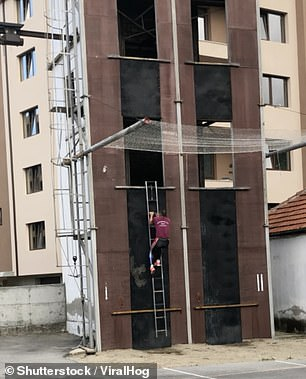When secured on the first floor, the man deftly swings his ladder up to the next floor in one smooth motion