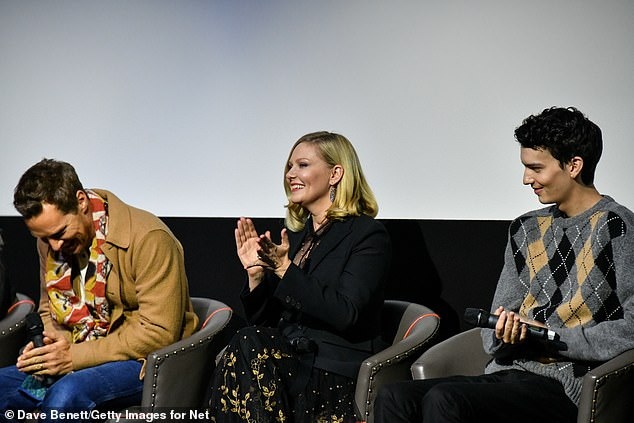 Screening: The couple attend a screening of their new film with Cody Smit-McPhee (Right) during the 65th BFI London Film Festival
