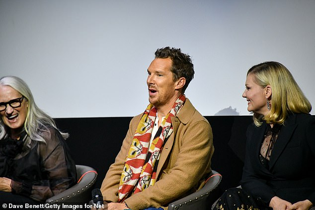 Dapper: Benedict, 45, wore a stylish cream jacket that he paired with a quirky cat print scarf