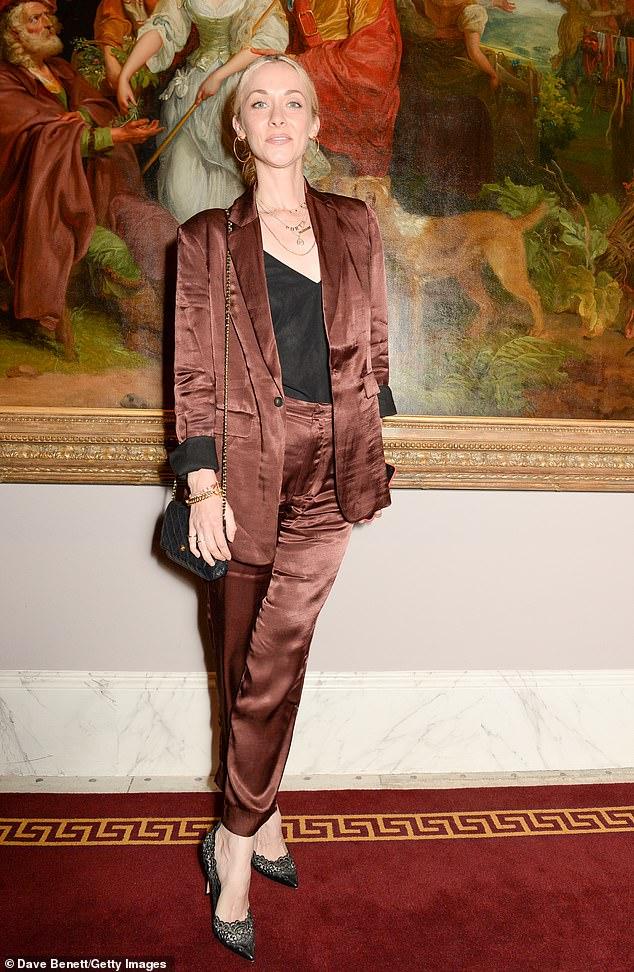 Sleek: Portia Freeman also made an appearance at the tee-time event, looking sleek in a matching satin pantsuit.