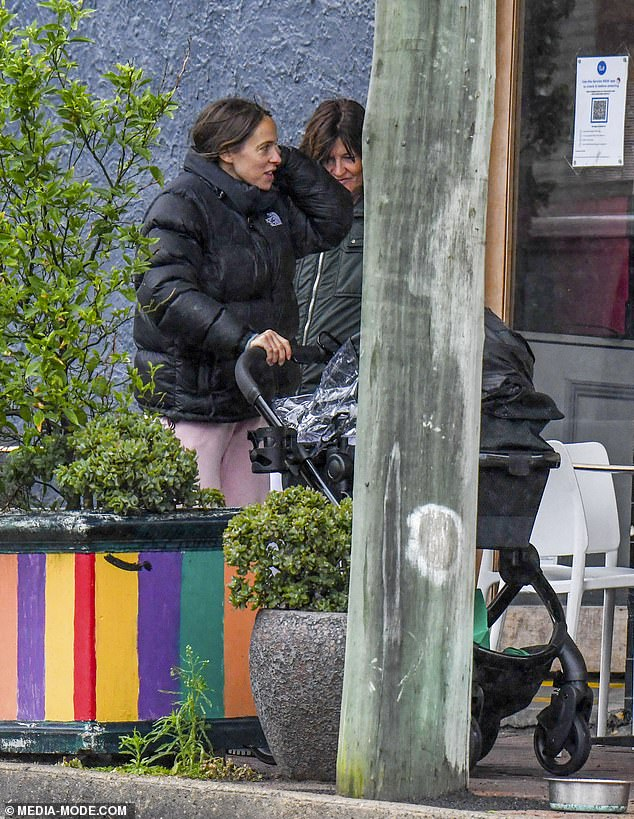 Comfort:Becky wore pink trackpants and a puffer jacket as she pushed her son in a pram