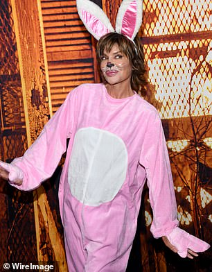 Cute: The 58-year-old soap star still allowed her signature brunette shag to shine, but decked out her face in black and white face paint to mimic bunny features