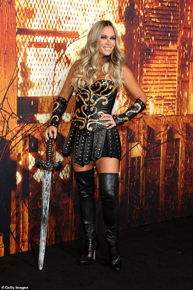 Gladiator: Mellencamp sent temperatures soaring as she arrived dressed as a sexy gladiator