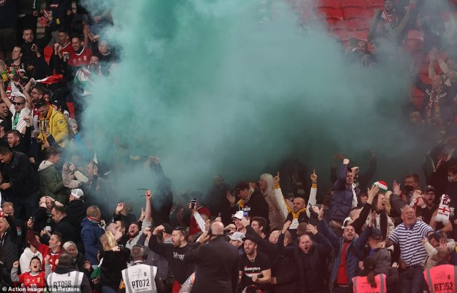 Hungarian fans set off a flare and chant raucously in the away end during the World Cup qualifier against England