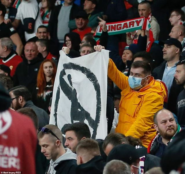 The Hungarian fan who was holding the banner protesting against taking the knee can be seen in this picture
