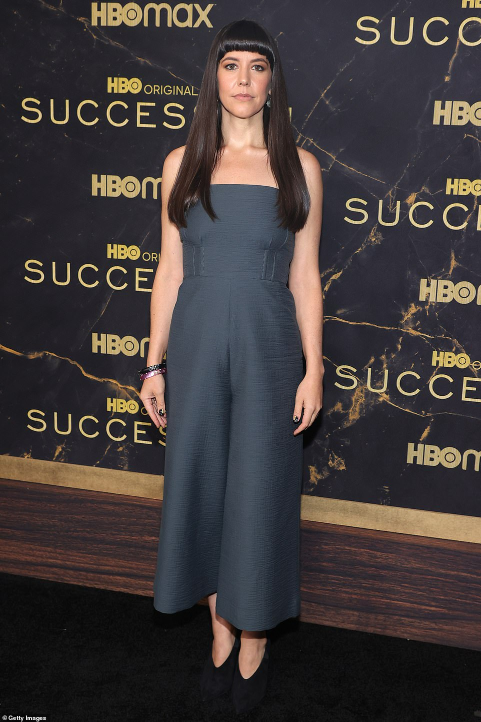 Modern muse:Zoe Winters, rocking a brunette micro-fringe and sleek strands, looked effortlessly cool in a strapless wide-legged jumpsuit and black mules
