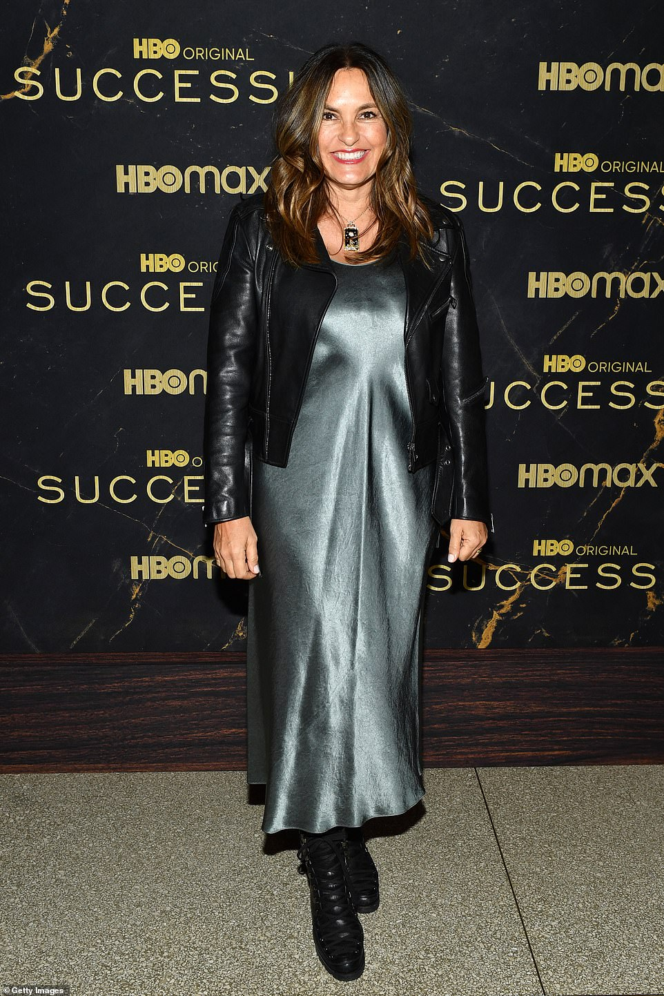 Edgy:Mariska Hargitay showed off her edgy side in a black motorcycle jacket layered over a blue slip dress