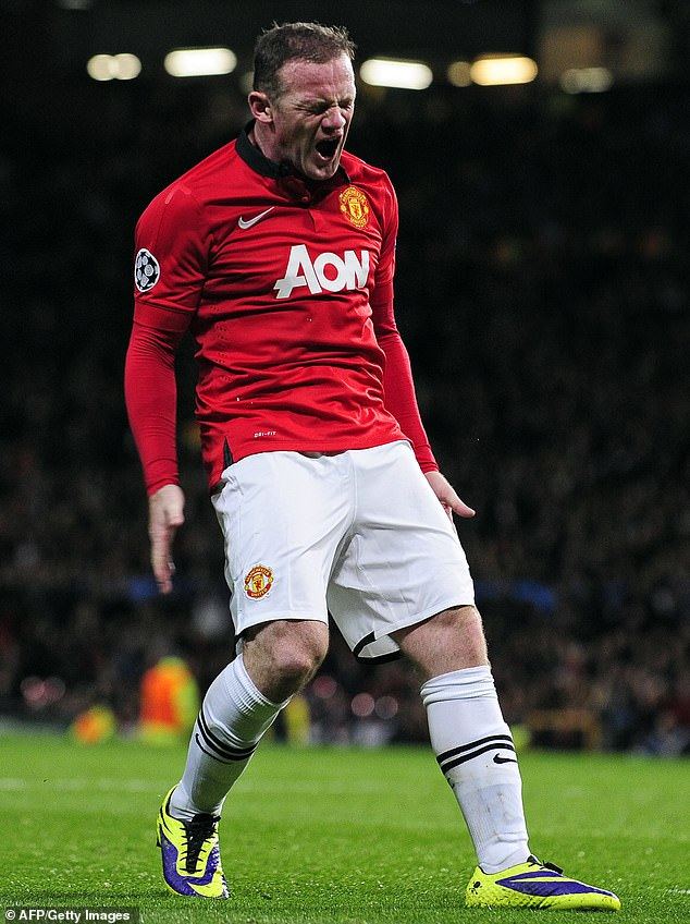 Wayne Rooney, 35, has revealed he 'struggled to cover up tough periods' in his life while playing for Manchester United and England in a new documentary (pictured in 2013 playing for Manchester United)