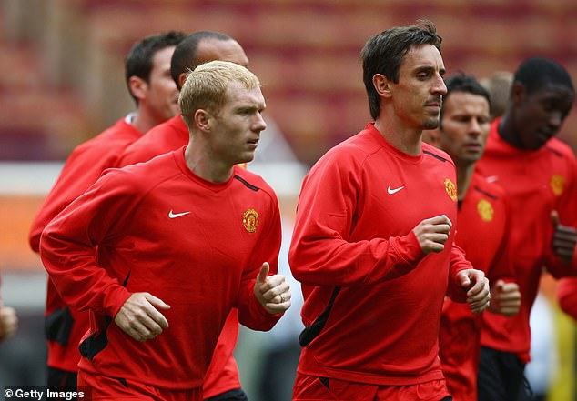 Gary Neville, pictured ahead of the Champions League final in Moscow in 2008, alongside Paul Scholes (left) and Ryan Giggs (right) rated the 2008 teams as the club's best ever