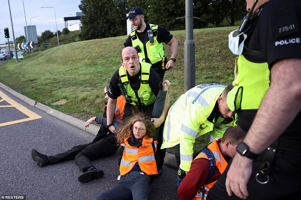 Police remove Insulate Britain activists as they block junction 31 of the M25 this morning