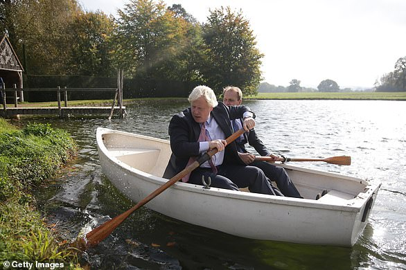 Foreign Secretary Boris Johnson and Czech Republic's Deputy Foreign Minister Ivo Sramek go out onto a boating lake in a rowing boat before attending a lunch meeting with other European foreign ministers at the British Foreign Secretary's official residence Chevening House on October 15, 2017 in Chevening