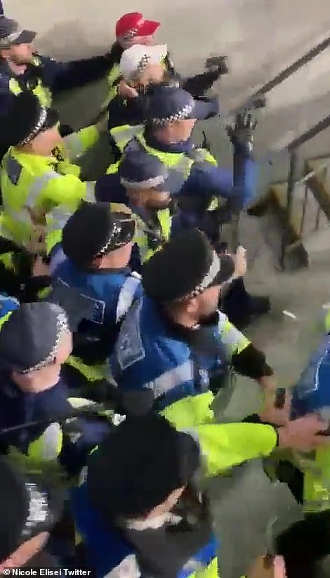 Shocking footage shows the Met fleeing as thug clambered over seats and each other to try to swing punches at policemen
