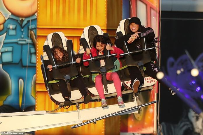 Fun times: The raven-haired beauty seemed to be in high spirits as she accompanied her kids on the ride as she made the most of her time in the capital after jetting off from Los Angeles for her new movie role.