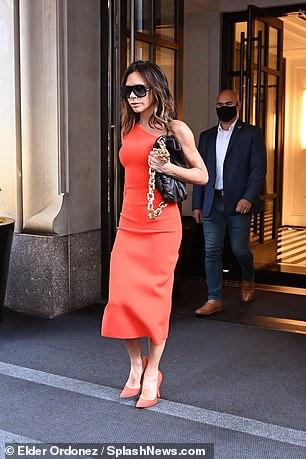 , Victoria Beckham shows off her figure in off-the-shoulder orange midi dress, The Evepost News