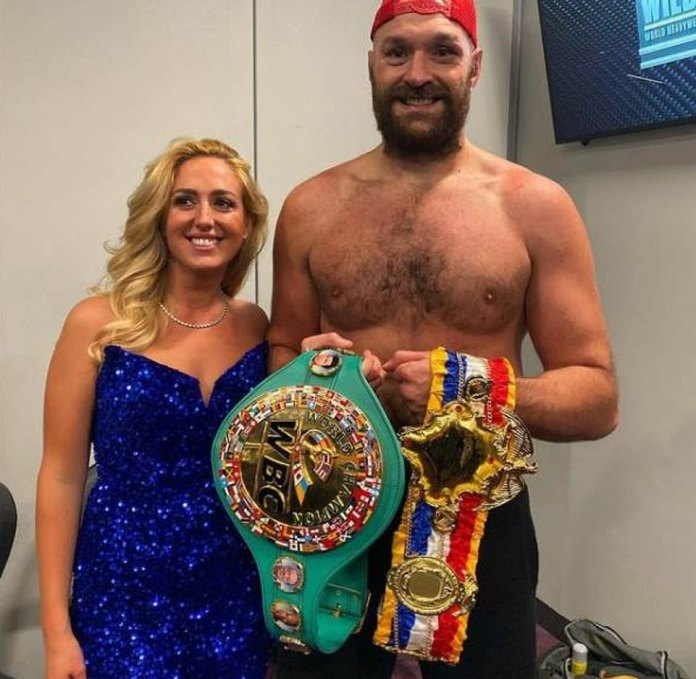 Champion: Fury, 33, beams for the camera with wife Paris after defeating Deontay Wilder in Las Vegas during Sunday's epic fight