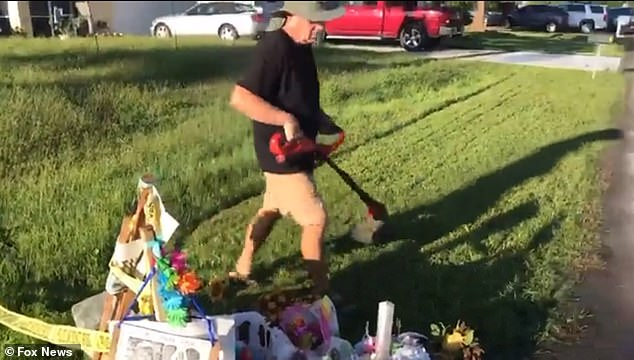 Brian Laundrie's father Chris, 62, was filmed trimming the grass around a makeshift memorial for his fugitive son's late fiancée Wednesday morning - 19 hours after the coroner announced Gabby Petito was strangled