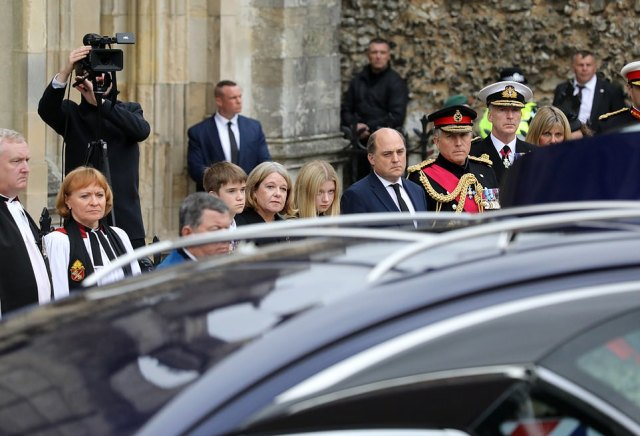 Admiral Sir Tony Radakin (pictured right in naval uniform) was among those attending his funeral at Winchester Cathedral, where Major General Holmes was laid to rest with full military honours. General Sir Nick Carter (to the left of Sir Tony), the outgoing Chief of the Defence Staff, Rear Admiral Mike Utley OBE, the Commander of the UK's Strike Force and Defence Minister Ben Wallace (next to Sir Nick) were also present. They are seen here next to Major General Holmes' wife Lea and their two children William, 11 and Eleanor, 15 (pictured centre)