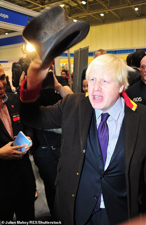 Mr Johnson waves a top hat at the 'Skills London' careers fair in 2013