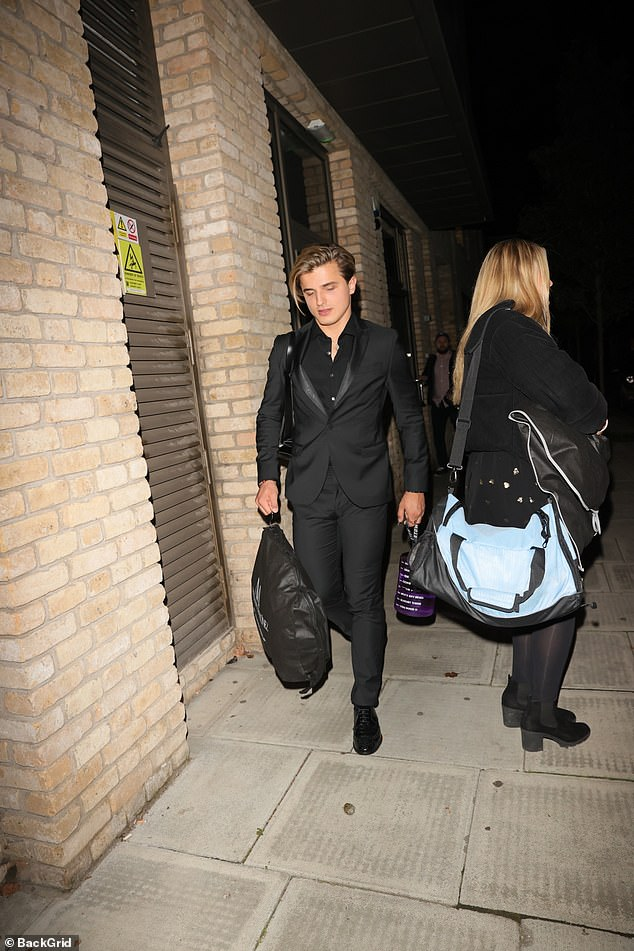 Smart:Nikita also donned all-black, looking suave in a suit, shirt and tie and polished shoes