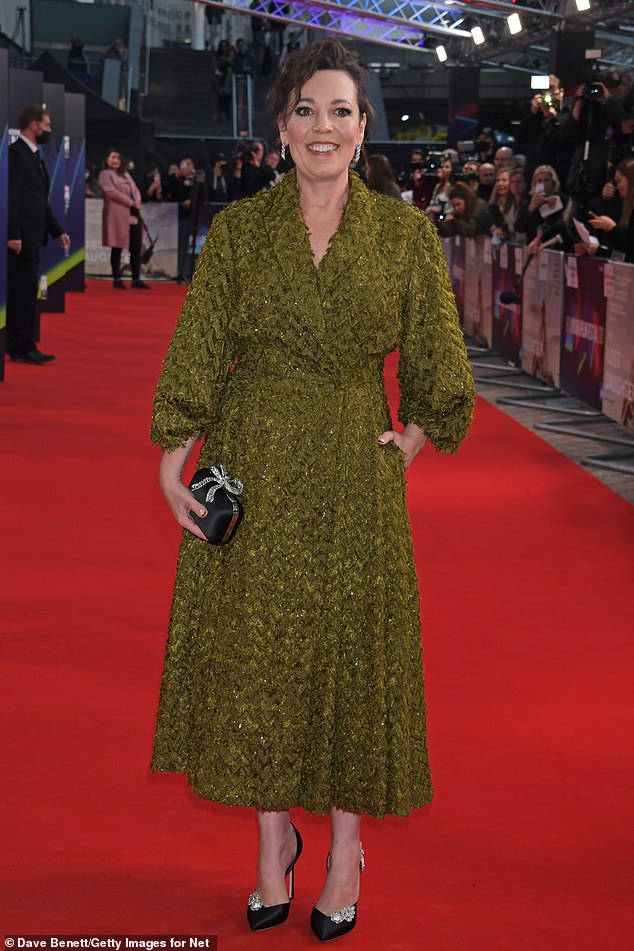 Outfit:The Crown star donned a dark green dress with a houndstooth print for the event