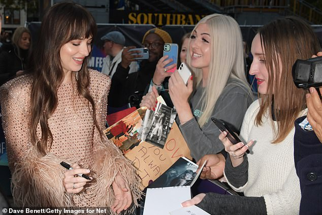 50 Shades Of Grey star: Dakota stopped to sign autographs
