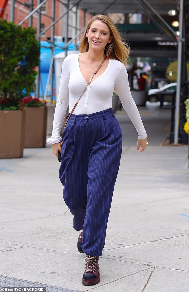 , Blake Lively sports a chic white long-sleeve with striped slacks while running errands in New York, The Habari News New York