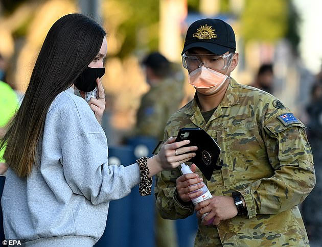 Students have dealt with more than 18 months of intermittent lockdowns (pictured: students at Qudos Bank Arena in Sydney line up for the Pfizer vaccine as defence force troops assist)