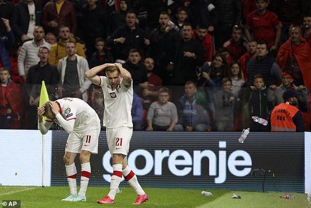 Albania's game against Poland was halted for 20 minutes after home fans threw objects