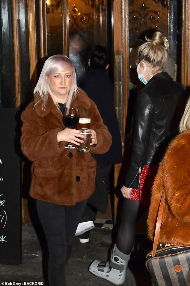 Deserved: Lily made her way into a packed London pub with a few friends