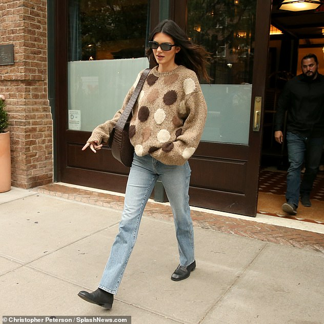 , Kendall Jenner bundles up in a cozy polka dot sweater with jeans while shopping in New York, The Evepost News