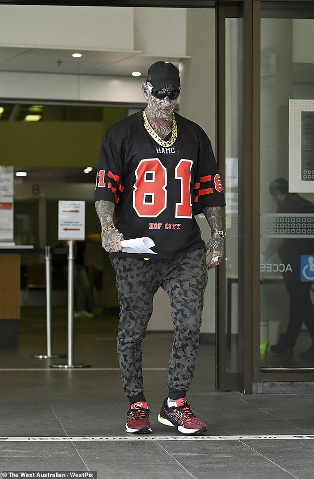 Dayne Brajkovich leaving court. A new law in Western Australia could force him to wear makeup to cover up his tattoos