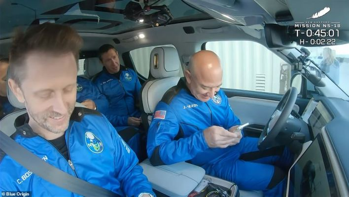 The crew was taken to the launch tower in a Rivian pickup truck, which was driven by Bezos