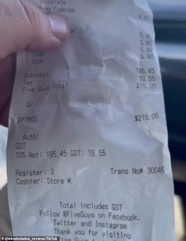 The order included six burgers, three milkshakes, four fries and four drinks, which came to a whopping cost of $215 and the outraged reviewer said it was a 'rip-off'