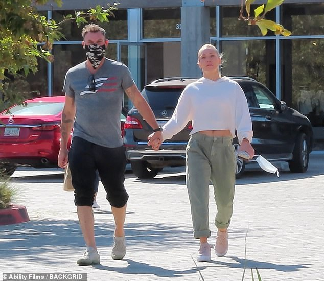 Out and about:Brian Austin Green, 48, and his girlfriend Sharna Burgess, 36, were snapped Wednesday enjoying a day out in Malibu, after he was voted off of Dancing with the Stars Tuesday