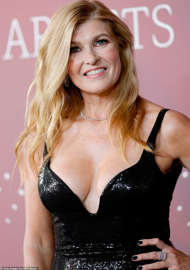 Radiant: The 54-year-old put on a busty display in a plunging sleeveless black gown that shimmered under the lights as she posed up a storm for the shutterbugs
