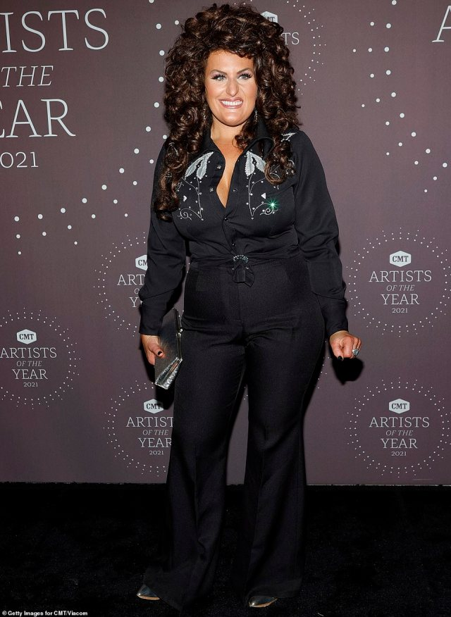 Tribute to a great:Hannah Dasher was old school country chic in an outfit reminiscent of Johnny Cash, including a black set of slacks and a matching button-down shirt with some glitzy embroidery